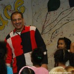 Mr. Amazing laughing with children at circus workshop
